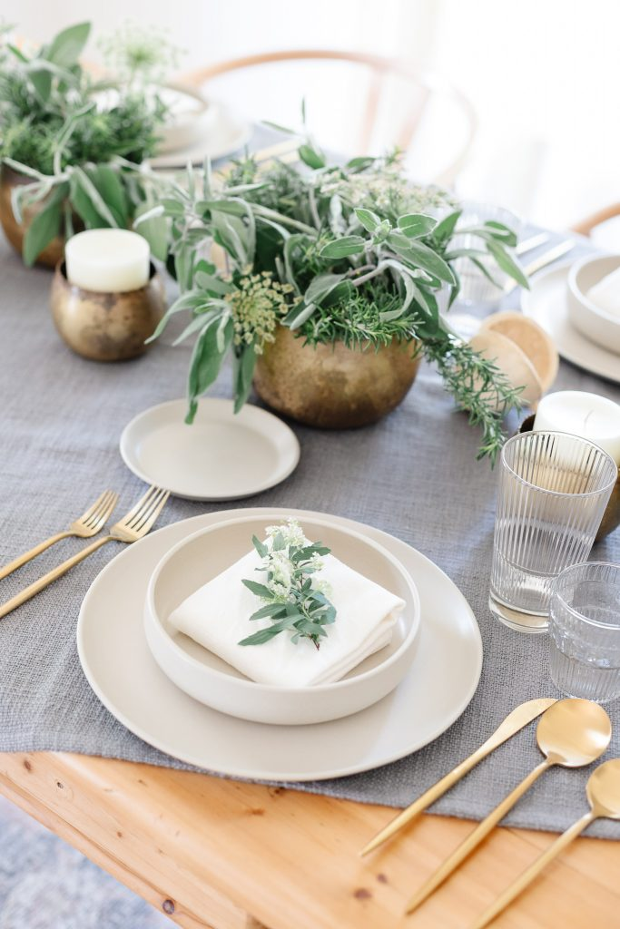 white dinner napkin with greenery on top