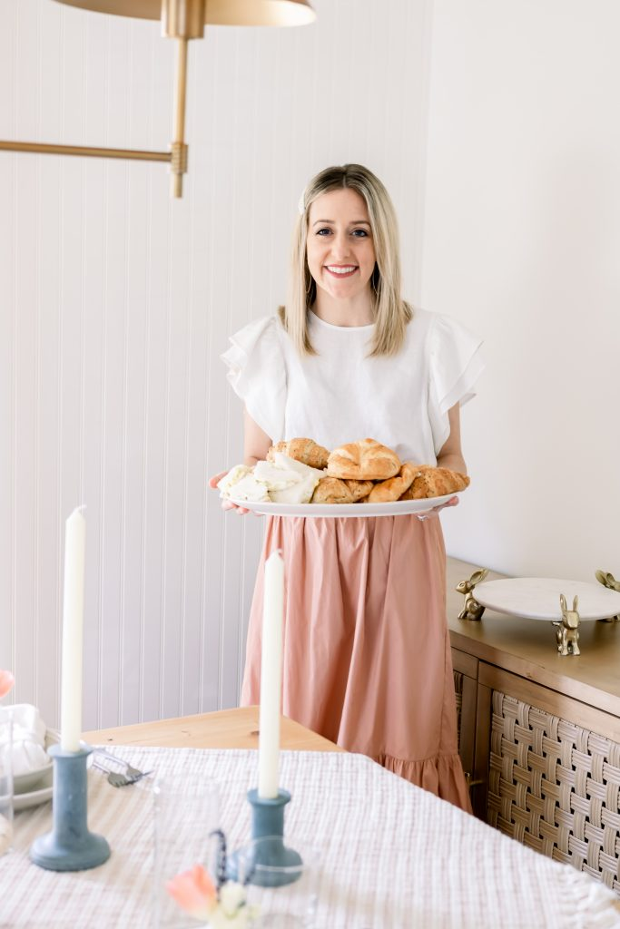 woman serving egg salad sandwiches in dining room