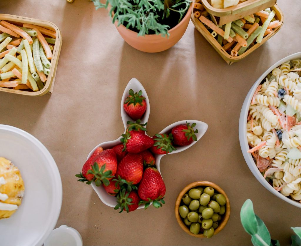 strawberries in a bunny bowl and pasta salad