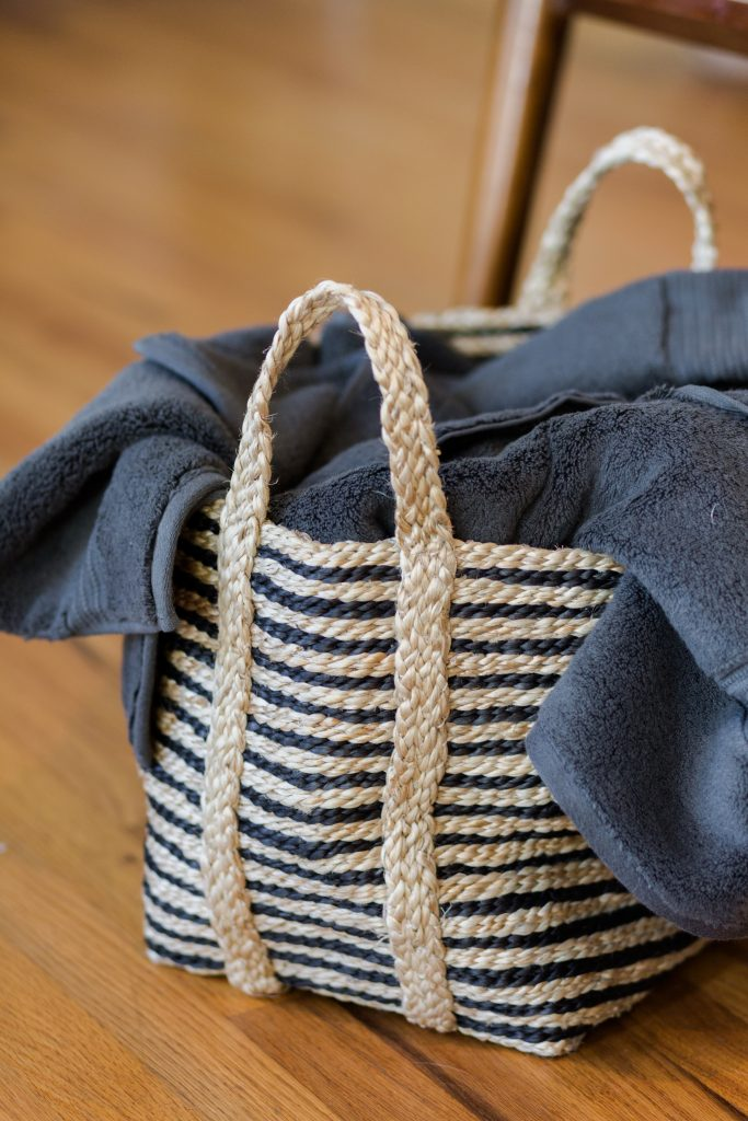 basket with a towel in it; after guests leave hostful hack
