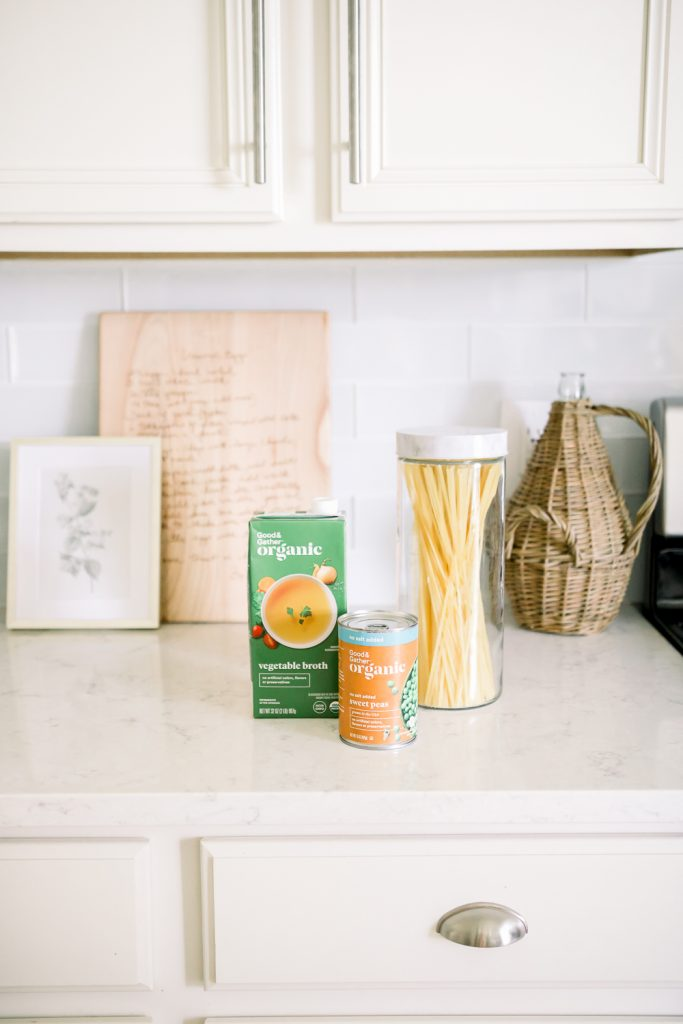 pantry staples on white counter with white kitchen cabinets